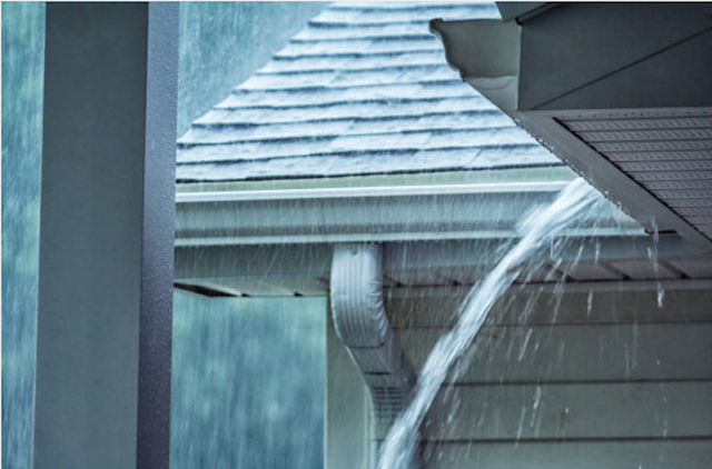 rainwater pouring out of gutters